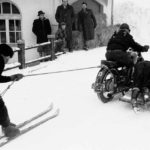 Vintage photo of skijoring skier pulled by motorbike with sidecar | Writer Mariecor | WriterMariecor.com