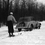 Vintage photo of Skijoring via automobile | Writer Mariecor | WriterMariecor.com